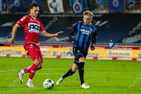 Kortrijk's Trent Sainsbury and Club's Noa Lang fight for the ball during a soccer match between Club Brugge and KV Kortrijk, Saturday 21 November 2020 in Brugge, on day 13 of the 'Jupiler Pro League' first division of the Belgian championship.