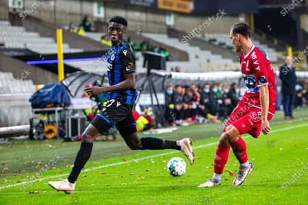 Club's Youssouph Badji and Kortrijk's Trent Sainsbury fight for the ball during a soccer match between Club Brugge and KV Kortrijk, Saturday 21 November 2020 in Brugge, on day 13 of the 'Jupiler Pro League' first division of the Belgian championship.