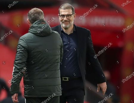 Manager Slaven Bilic (R) of West Bromwich greets Manchester United's head coach Ole Gunnar Solskjaer (L) after the English Premier League soccer match between Manchester United and West Bromwich Albion in Manchester, Britain, 21 November 2020.
