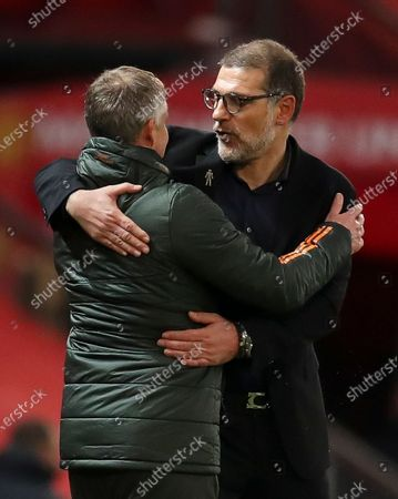 Stock Photo of Manager Slaven Bilic (R) of West Bromwich greets Manchester United's head coach Ole Gunnar Solskjaer (L) after the English Premier League soccer match between Manchester United and West Bromwich Albion in Manchester, Britain, 21 November 2020.
