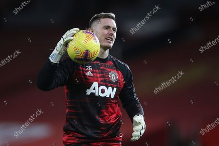 Manchester United's goalkeeper Dean Henderson warms up for the English Premier League soccer match between Manchester United and West Bromwich Albion in Manchester, Britain, 21 November 2020.