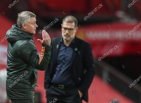 Manchester United's head coach Ole Gunnar Solskjaer (L) reacts during the English Premier League soccer match between Manchester United and West Bromwich Albion in Manchester, Britain, 21 November 2020.