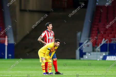 Lionel (Leo) Messi of FC Barcelona and Stefan Savic of Atletico de Madrid looks on during the spanish league, La Liga Santander, football match played between Atletico de Madrid and FC Barcelona at Wanda Metropolitano stadium on November 21, 2020, in Madrid, Spain.