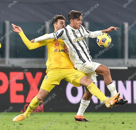 Juventus' Paulo Dybala (R) and Cagliari's Sebastian Walukiewicz in action during the Italian Serie A soccer match Juventus FC vs Cagliari Calcio at the Allianz stadium in Turin, Italy, 21 November 2020.