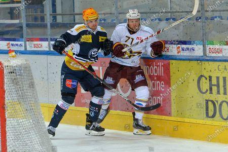 Stock Photo of Topscorer Julius Naettinen (Ambri) against #71 Tanner Richard (Genf)