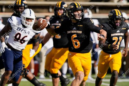 Southern Mississippi quarterback Tate Whatley (6) passes while pursued by UTSA linebacker Charles Wiley (96) during the first half of an NCAA college football game, in Hattiesburg, Miss