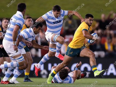 Stock Image of Australia's Tom Wright, right, outruns Argentina's defence during their Tri-Nations rugby union match in Newcastle, Australia, . The game ended in a 15-15 draw