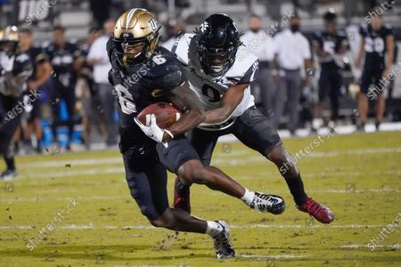 Central Florida wide receiver Marlon Williams (6) gains yardage in front of Cincinnati cornerback Arquon Bush after a reception during the second half of an NCAA college football game, in Orlando, Fla