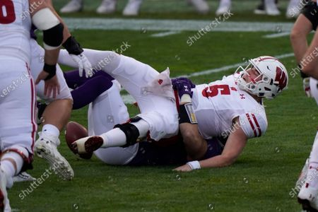 Wisconsin quarterback Graham Mertz is sacked by Northwestern linebacker Blake Gallagher during the first half of an NCAA college football game in Evanston, Ill