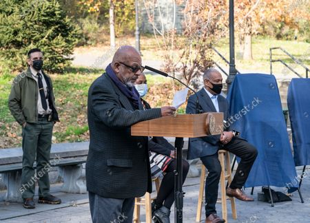 Author Eric Washington speaks during parks naming at St. Nicholas Park. Lawn in the park has been named after James Baldwin and playground after Langston Hughes.