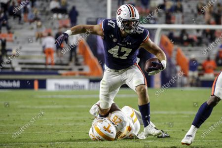 Auburn tight end John Samuel Shenker (47) is tackled by Tennessee defensive back Theo Jackson (26) after a reception during the second half of an NCAA college football game, in Auburn, Ala