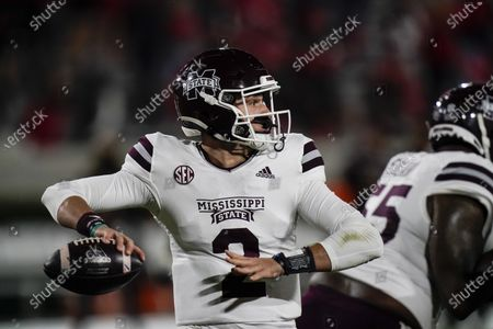 Mississippi State quarterback Will Rogers looks for a receiver during the first half of the team's NCAA college football game against Georgia, in Athens, Ga