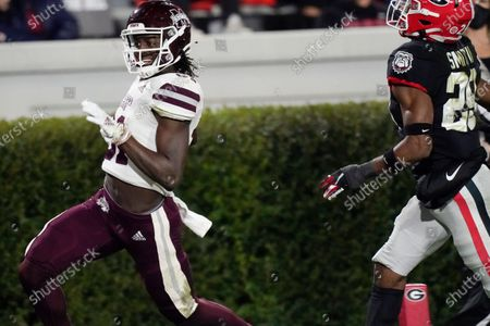 Mississippi State wide receiver Jaden Walley (31) scores a touchdown next to Georgia defensive back Christopher Smith during the first half of an NCAA college football game, in Athens, Ga
