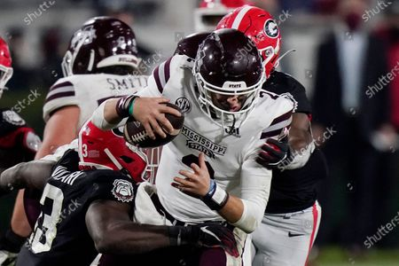 Georgia linebacker Azeez Ojulari (13) and a teammate sack Mississippi State quarterback Will Rogers (2) during the second half of an NCAA college football game, in Athens, Ga