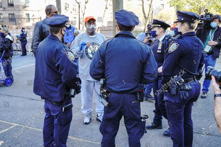 Stock Image of Tracy Morgan seen talking to NYPD officers during the Thanksgiving celebration in New York City.