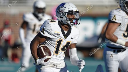 Appalachian State's Malik Williams runs a kickoff up the field during the second half of an NCAA college football game against Coastal Carolina, in Conway, S.C. Coastal Carolina won 34-23