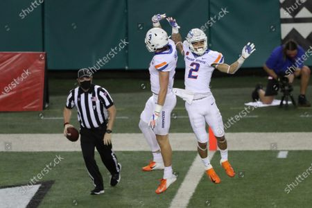 Boise State wide receiver Khalil Shakir (2) and tight end Riley Smith (3) celebrate a Shakir touchdown against Hawaii during the second quarter of an NCAA college football game, in Honolulu