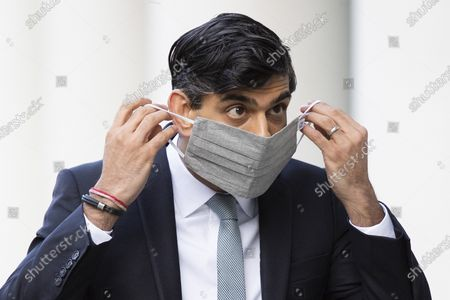 Stock Picture of Chancellor of the Exchequer Rishi Sunak puts on a mask as he arrives at the BBC. Later he will appear on the Andrew Marr Show.