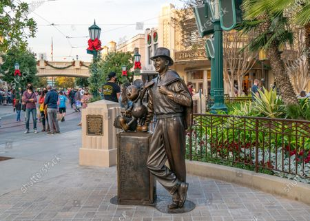General views of the Walt Disney and Mickey Mouse 'Storytellers' statue on Buena Vista Street at Disney California Adventure Park, partially reopened for outdoor food and shopping with new COVID-19 guidelines in place