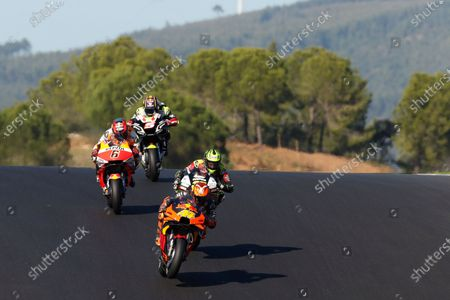 Stock Picture of MotoGP rider Pol Espargaro of Spain steers his motorcycle ahead of Cal Crutchlow of Great Britain, Stefan Bradl of Germany and ohann Zarco of France during the MotoGP race of the Portuguese Motorcycle Grand Prix, the last race of the season, at the Algarve International circuit near Portimao, Portugal