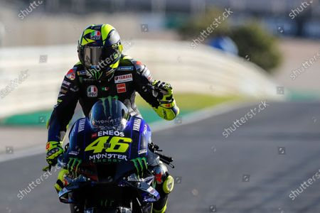 MotoGP rider Valentino Rossi of Italy reacts at the end of the Portuguese Motorcycle Grand Prix, the last race of the season, at the Algarve International circuit near Portimao, Portugal
