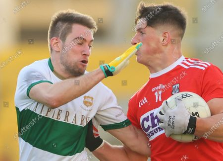 Cork vs Tipperary. Tipperary's Bill Maher and Colm O'Callaghan of Cork