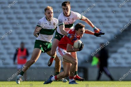Cork vs Tipperary. Cork's Mark Collins is tackled by Alan Campbell and Kevin Fahey of Tipperary