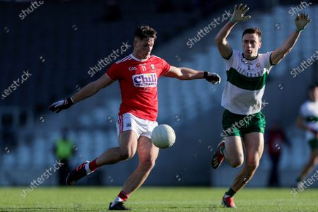 Cork vs Tipperary. Cork's Colm O'Callaghan scores a point despite Alan Campbell of Tipperary