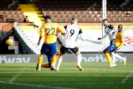 Fulham's Ruben Loftus-Cheek, 2nd from right, scores his side's second goal during the English Premier League soccer match between Fulham and Everton, at Craven Cottage stadium, London