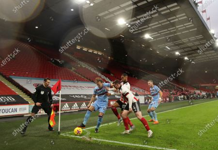 Stock Picture of West Ham's Mark Noble, left, duels for the ball with Sheffield United's Max Lowe, centre, and Sheffield United's John Fleck during the English Premier League soccer match between Sheffield United and West Ham United at Bramall Lane stadium in Sheffield, England