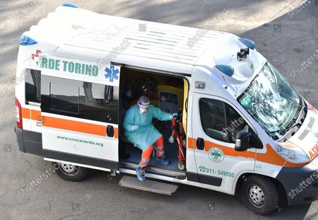 One of the first patients arrives in an ambulance at at the temporary hospital for Covid-19 set up in pavilion 5 of Torino Esposizioni at Parco del Valentino, Turin, Italy, 22 November 2020. The Italian health authorities are transforming a Turin top art exhibitions venues into a temporary 100 bed capacity hospital.