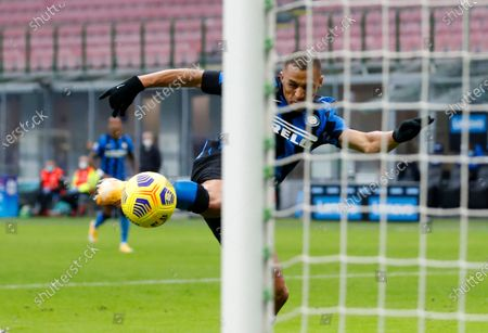 Inter Milan's Alexis Sanchez scores his side's opening goal during the Serie A soccer match between Inter Milan and Torino at the San Siro Stadium, in Milan, Italy