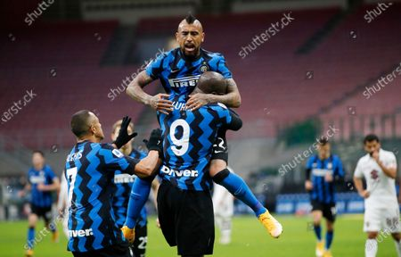 Inter Milan's Romelu Lukaku, bottom right, celebrates with his teammates Arturo Vidal, top, and Alexis Sanchez after scoring his side's third goal during the Serie A soccer match between Inter Milan and Torino at the San Siro Stadium, in Milan, Italy