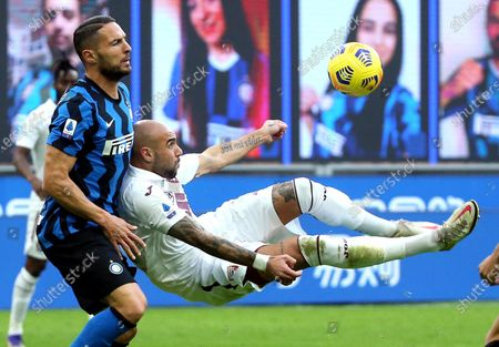 Inter Milan's Danilo D'Ambrosio (L) challenges for the ball Torino's Simone Zaza during the Italian Serie A soccer match FC Inter vs Torino FC at Giuseppe Meazza stadium in Milan, Italy, 22 November 2020.