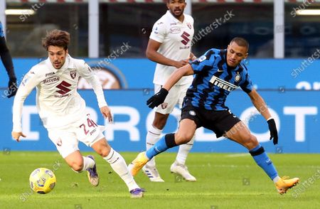 Torino's Simone Verdi (L) challenges for the ball  Inter Milan's Alexis Sanchez during the Italian Serie A soccer match FC Inter vs Torino FC at Giuseppe Meazza stadium in Milan, Italy, 22 November 2020.