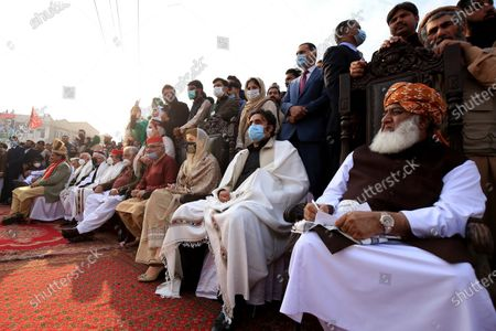 Stock Picture of Leaders of an alliance of major opposition political parties, Maulana Fazal ur Rehman (R) of Jamiat Ulma-e-Islam (F), Bilawal Bhutto Zardari of Pakistan People Party and Maryam Nawaz of Pakistan Muslim League Nawaz attend a gathering during an anti-government protest, in Peshawar, Pakistan, 22 November 2020. The country's 11 opposition parties, including Pakistan Muslim League (PMLN) and Pakistan People's Party (PPP), on 20 September launched the Pakistan Democratic Movement (PDM) to start countrywide protests against Prime Minister Imran Khan's government and military's alleged role in politics.