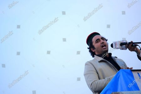 Bilawal Bhutto Zardari, leader of opposition political party Pakistan People Party part of an alliance of major opposition political parties, Pakistan Democratic Movement (PDM) attends a gathering during an anti-government protest, in Peshawar, Pakistan, 22 November 2020. The country's 11 opposition parties, including Pakistan Muslim League (PMLN) and Pakistan People's Party (PPP), on 20 September launched the Pakistan Democratic Movement (PDM) to start countrywide protests against Prime Minister Imran Khan's government and military's alleged role in politics.