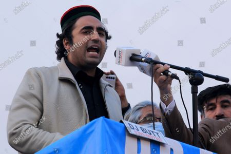 Stock Photo of Bilawal Bhutto Zardari, leader of opposition political party Pakistan People Party part of an alliance of major opposition political parties, Pakistan Democratic Movement (PDM) attends a gathering during an anti-government protest, in Peshawar, Pakistan, 22 November 2020. The country's 11 opposition parties, including Pakistan Muslim League (PMLN) and Pakistan People's Party (PPP), on 20 September launched the Pakistan Democratic Movement (PDM) to start countrywide protests against Prime Minister Imran Khan's government and military's alleged role in politics.