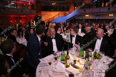 2016 Autosport Awards.  Grosvenor House Hotel, Park Lane, London. Sunday 4 December 2016.  Jonny Kane wins the use of a Mercedes Coupe for a year in a raffle. Guests on his table include David Brabham. World Copyright: Jed Leicester/LAT Images.