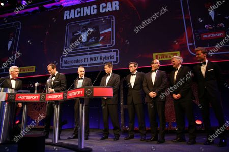 2016 Autosport Awards.  Grosvenor House Hotel, Park Lane, London. Sunday 4 December 2016.  Alado Costa accepts the prize for Racing Car of the Year for the design team of the Mercedes W07 Hybrid. Steve Rider and Nico Rosberg are also on stage. World Copyright: Jed Leicester/LAT Images.