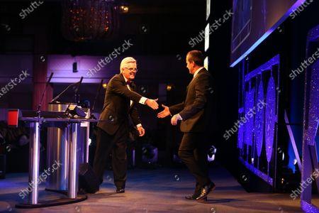 2016 Autosport Awards.  Grosvenor House Hotel, Park Lane, London. Sunday 4 December 2016.  Steve Rider greets Volkswagen WRC technical chief Francois Demaison. World Copyright: Jed Leicester/LAT Images.