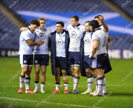 (L to R) Duncan Taylor, Chris Harris, Sam Johnson, Scott Cummings, Fraser Brown and Zander Fagerson - Scotland players stand dejected following defeat to France at the end of the match.