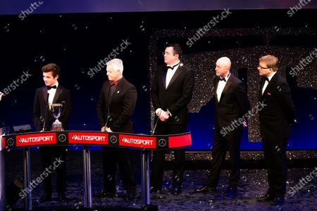 2016 Autosport Awards. Grosvenor House Hotel, Park Lane, London. Sunday 4 December 2016. Lando Norris accepts the 2016 McLaren Autosport BRDC Award from Derek Warwick. Eric Boullier, David Brabham and Kevin Turner look on. World Copyright: /LAT Photographic.