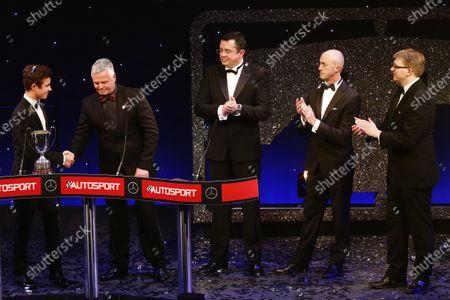 2016 Autosport Awards. Grosvenor House Hotel, Park Lane, London. Sunday 4 December 2016. Lando Norris accepts the 2016 McLaren Autosport BRDC Award from Derek Warwick. Eric Boullier, David Brabham and Kevin Turner applaud. World Copyright: /LAT Photographic.