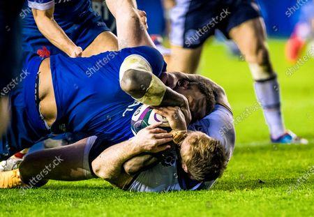 Scotland vs France. France's Virimi Vakatawa scores a try despite Stuart Hogg of Scotland
