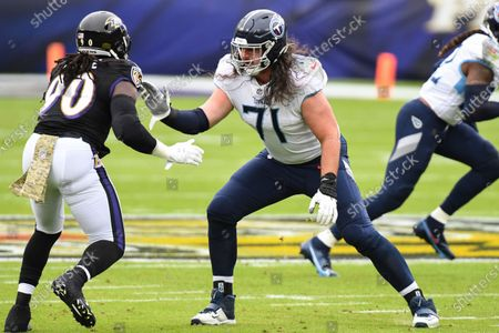 Tennessee Titans offensive tackle Dennis Kelly (71) in action against Baltimore Ravens outside linebacker Pernell McPhee (90) during the first half of an NFL football game, in Baltimore