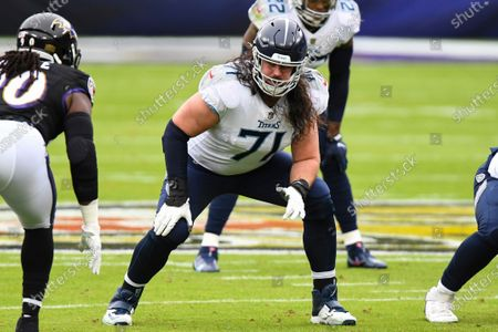 Tennessee Titans offensive tackle Dennis Kelly (71) in action during the first half of an NFL football game against the Baltimore Ravens, in Baltimore