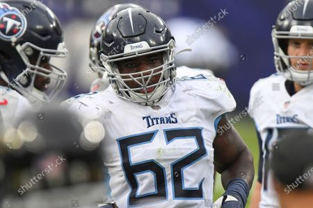 Tennessee Titans center Aaron Brewer (62) looks on during the second half of an NFL football game against the Baltimore Ravens, in Baltimore