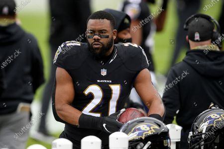 Baltimore Ravens running back Mark Ingram (21) stands on the field before an NFL football game against the Tennessee Titans, in Baltimore