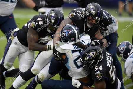 Tennessee Titans running back Derrick Henry (22) is tackled by Baltimore Ravens defensive end Derek Wolfe (95), inside linebacker Patrick Queen (48) and linebacker Tyus Bowser (54) during the second half of an NFL football game, in Baltimore